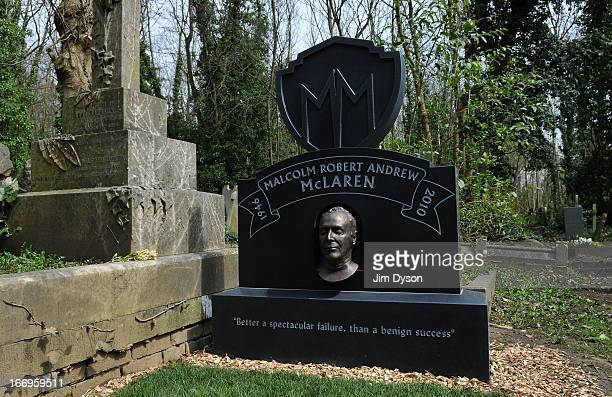 The gravestone of Punk impresario Malcolm McLaren is unveiled at Highgate Cemetery on April 17 2013 in London England The black granite headstone...