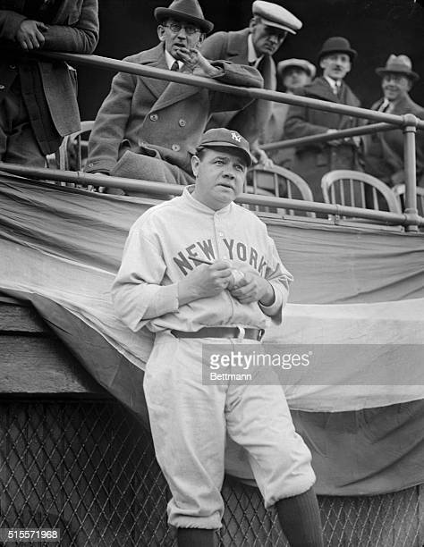 The Great Babe Ruth pauses to autograph a baseball during the 1924 season three years before he set the home run record of 60 as a member of the New...