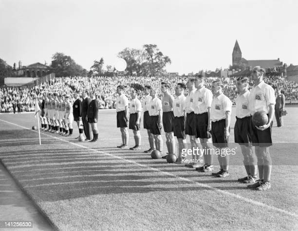 The Great Britain and Netherlands football teams before their first round match at Highbury Stadium during the London Olympics 31st July 1948 Great...