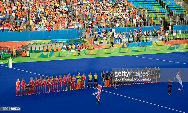 The Great Britain and Netherlands teams line up before the Women's Hockey Gold medal match between The Netherlands and Great Britain on Day 14 of the...