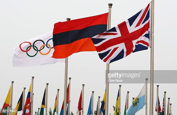 The Great Britain flag flies alongside the Olympic standard and the national flag of Armenia during the flag raising ceremony at the Olympic Village...