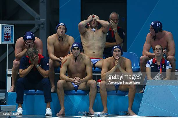 The Great Britain interchange players and coach react in their Men's Water Polo Preliminary Round Group B match against Romania on Day 2 of the...