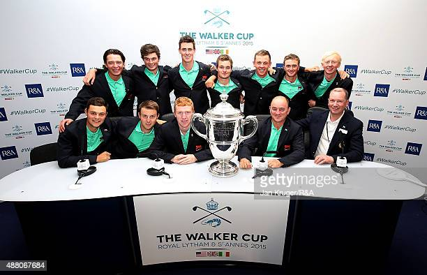 The Great Britain Ireland team pose with the trophy Team Captain Nigel Edwards and Championship Director Euan Mordaunt following the Sunday Singles...