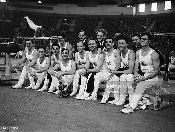 The Great Britain men's gymnastics team at Empress Hall, Earl's Court, during the Olympic Games, London, 12th August 1948. At their feet is 'Alec'...
