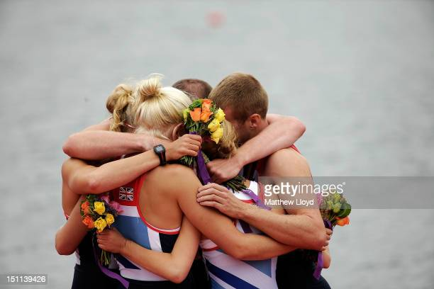 The Great Britain Mixed Coxed Four Rowing LTAMix4 team hug each other during the medal ceremony after winning gold on day 4 of the London 2012...