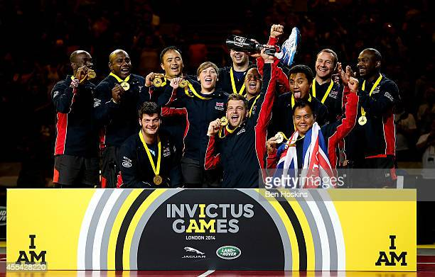 The Great Britain team celebrate after winning gold in the Sitting Volleyball on day 4 of the Invictus Games at Olympic Park on September 14 2014 in...