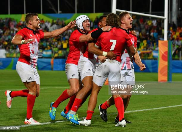 The Great Britain team celebrate the try of Dan Bibby of Great Britain to win the game in extra time during the Men's Rugby Sevens quarter final...