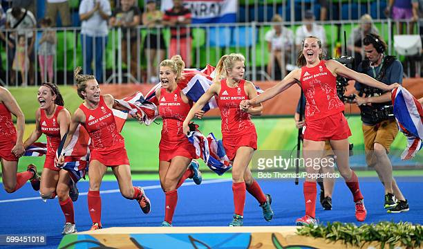 The Great Britain team celebrate victory in the Women's hockey Gold medal match between The Netherlands and Great Britain on Day 14 of the Rio 2016...