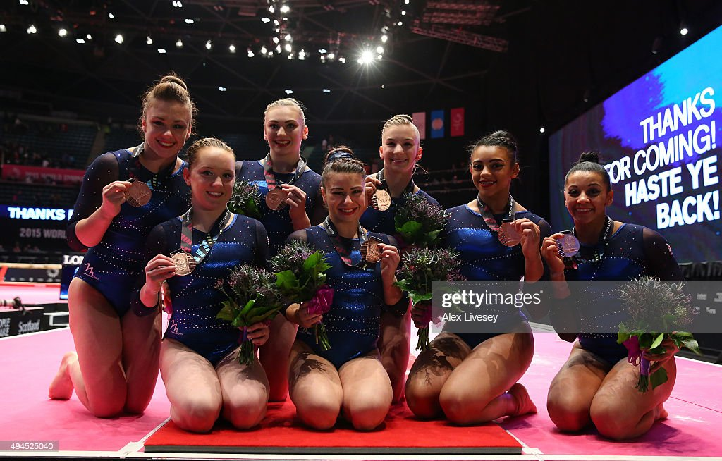 The Great Britain team celebrates winning Bronze on Day 5 of the 2015 World Artistic Gymnastics Championships at The SSE Hydro on October 27, 2015 in Glasgow, Scotland.