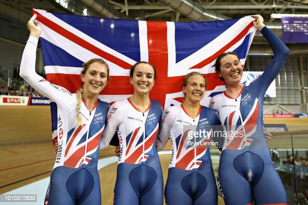 The Great Britain team Laura Kenny Elinor Barker Neah Evans and Emily Archibald celebrate winning the gold medal in the Womens Team Pursuit during...