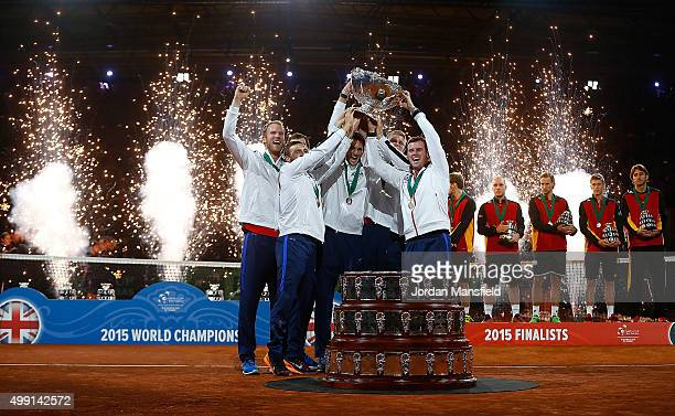 The Great Britain team lift the trophy following their victory during day three of the Davis Cup Final match between Belgium and Great Britain at...