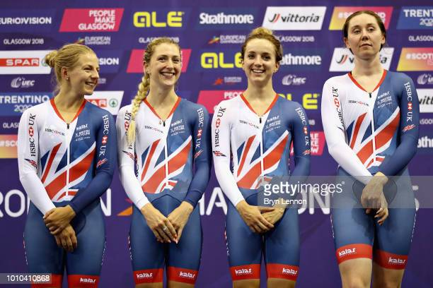 The Great Britain team Neah Evans Laura Kenny Elinor Barker and Katie Archibald celebrate winning the gold medal in the Womens Team Pursuit during...
