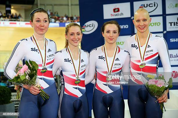 The Great Britain team of Katie Archibald Laura Trott Elinor Barker and Joanna Rowsell celebrate with the silver medals won in the Women's Team...