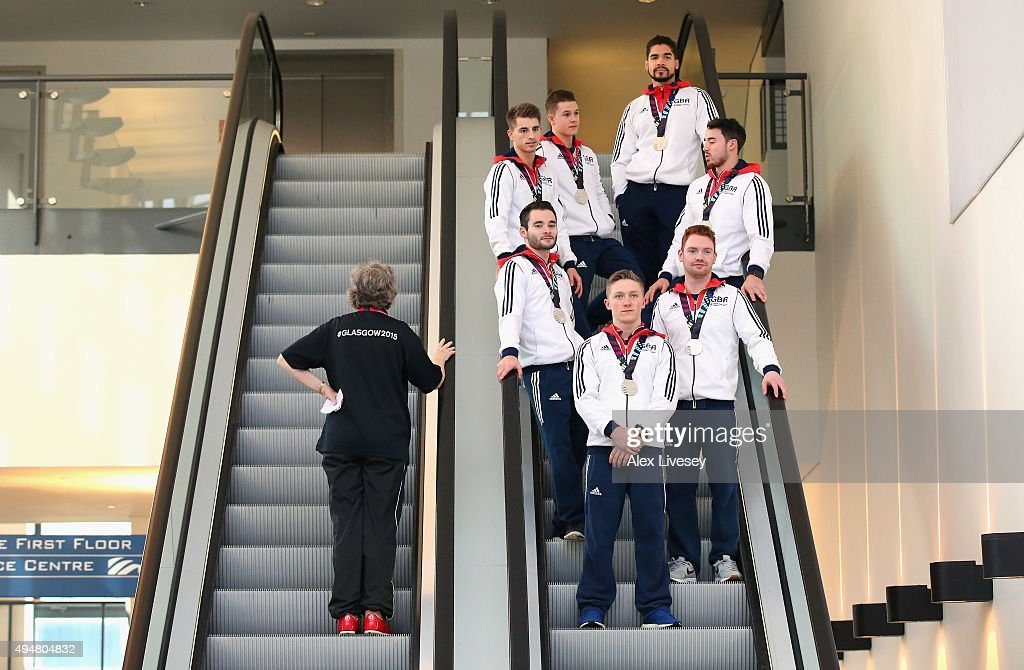 The Great Britain team of Nile Wilson, Daniel Purvis, James Hall, Max Whitlock, Kristian Thomas, Brinn Bevan and Louis Smith wear their silver medals won in the Team Final yesterday as they make their way to a round of TV interviews before day seven of the 2015 World Artistic Gymnastics Championships at The SSE Hydro on October 29, 2015 in Glasgow, Scotland.