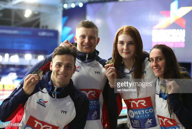The Great Britain team pose with their Gold Medals after finishing first in the 4 x 100m Medley Relay Mixed during the swimming on Day five of the...