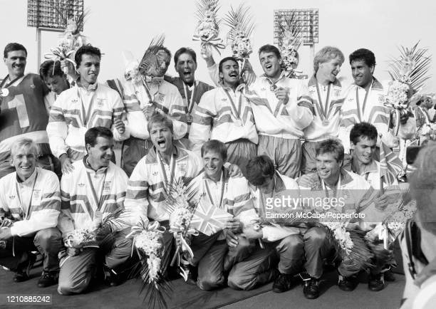 The Great Britain team with their gold medals following their 31 defeat of West Germany in the final of the men's field hockey tournament during the...