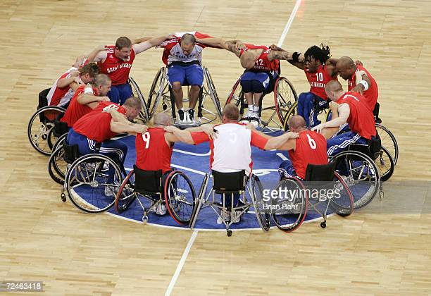 The Great Britain wheelchair basketball team celebrate together after defeating the USA in the quarterfinals on September 25 2004 during the 2004...