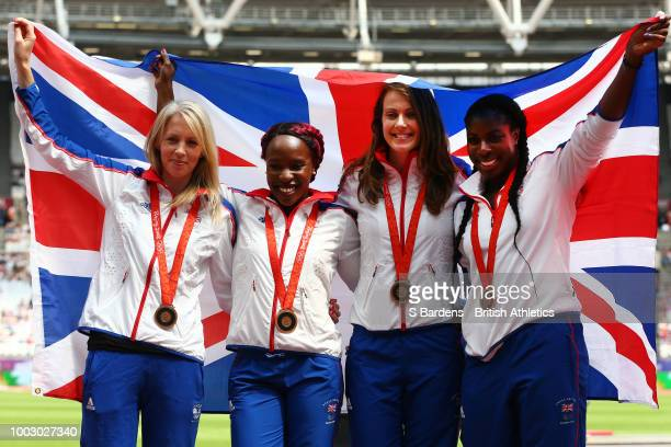 The Great Britain Women's 4x400m relay team celebrate receiving their reallocated bronze medals from the 2008 Beijing Olympic Games during Day One of...