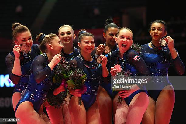 The Great Britain Women's team celebrates winning Bronze on Day 5 of the 2015 World Artistic Gymnastics Championships at The SSE Hydro on October 27...
