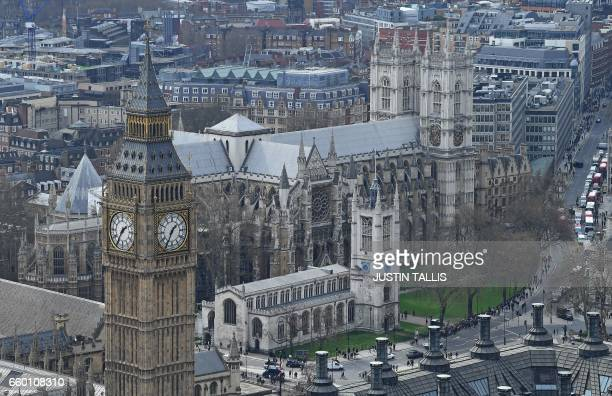 The Great Clocks of the Elizbeth Tower commonly known as the Big Ben and part of the House of Commons is pictured in front of Westminster Abbey in...