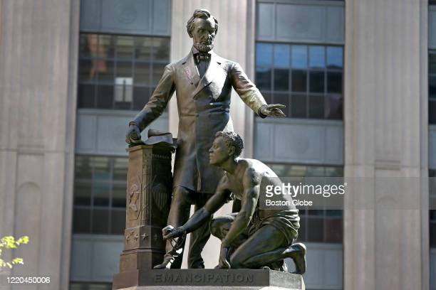 """The """"Great Emancipator"""" emancipation memorial of Abraham Lincoln standing over a kneeling freed slave in Boston's Park Square on June 12, 2020. Tory..."""