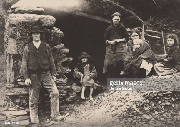 The Great Famine. A family at the ruins of their house in Killarney, 1888. Private Collection.