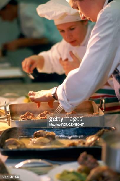 The great French chef Helene DARROZE cooking La chef cuisinier française Hélène DARROZE aux fourneaux