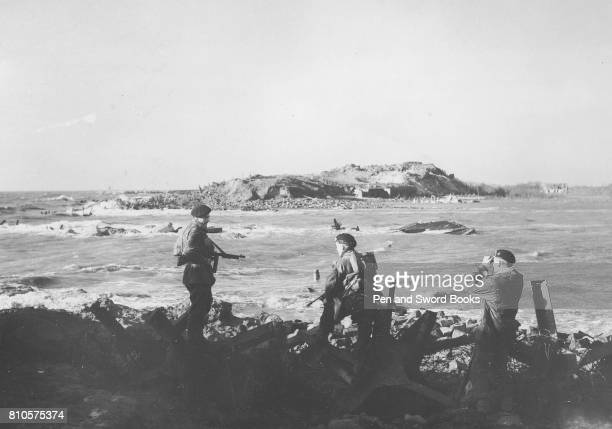 The great gap blasted in the seawall of Walcheren by the RAF which flooded the Island Taking time out to admire the RAF marksmanship are left to...