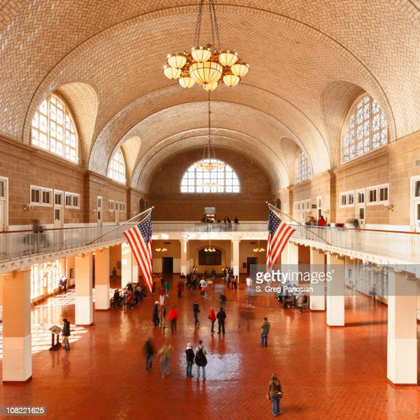 the great hall at ellis island in new york city - ellis island stock photos and pictures