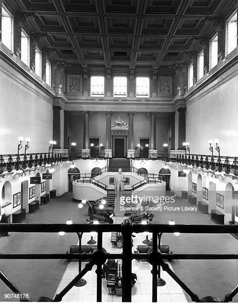 The Great Hall is shown looking north from the balcony with the entrance to the Shareholders' Room visible at the top of the stairs Stephenson's...