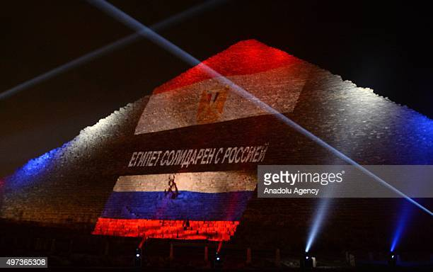 The Great Pyramid is illuminated in the colours of the Russian flag in order to show solidarity after Russian Airbus A321 aircraft crashed in Sinai...