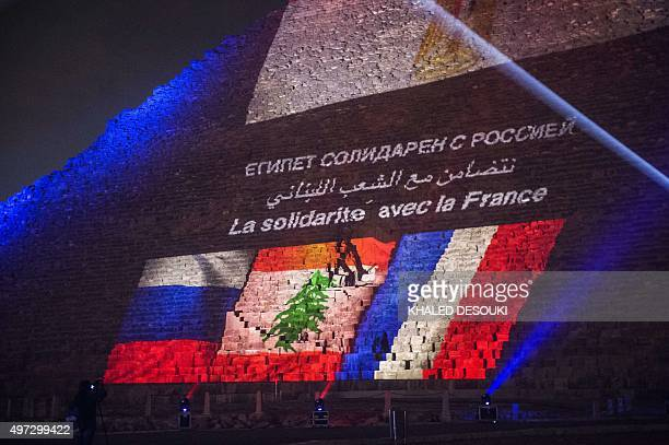 The great pyramid of Khufu is illuminated with the French, Lebanese and Russian flags in Giza, outskirt of Cairo on November 15 during a ceremony in...