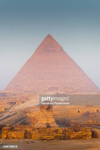 the great pyramids of giza at sunrise - giza pyramids stock pictures, royalty-free photos & images