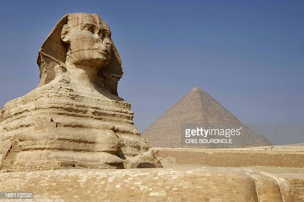 The Great Sphinx of Giza a large halfhuman halflion Sphinx statue on the Giza Plateau on the west bank of the Nile River near modernday Cairo seen...