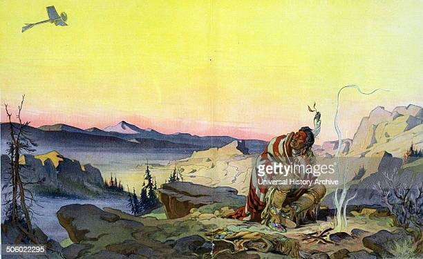 The great spirit by Udo Keppler 18721956 artist 1914 Illustration shows a Native man sitting before a small fire in a wilderness setting holding a...