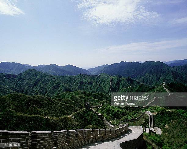 The Great Wall In 214 BC Shih Huang Ti the first emperor of a united China connected a number of existing defensive walls into a single system...