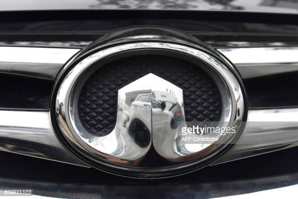 The Great Wall Motor logo is seen on a car outside a showroom in Beijing on August 22 2017 China's Great Wall Motor signalled on August 21 its...