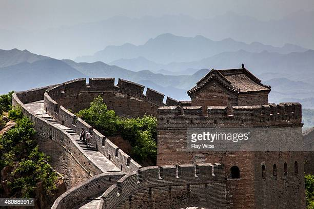 The Great Wall of China - the layers in this photo are compressed by the zoom lens which also brings the distant hills closing to this famous...