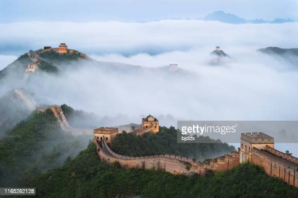 the great wall of jinshan mountains in the cloud sea - ancient stock pictures, royalty-free photos & images