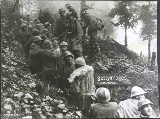 The Great War 19141918 Whats up above In the course of an Austrian attack on the Isonzo the Italians seen in this photograph have been captured They...