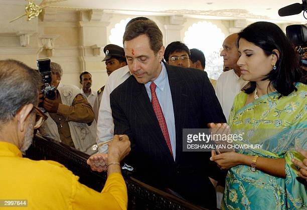 The Great-grandson of Henry Ford, founder of the Ford Motor Company,Alfred B. Ford watched by his wife Sharmila takes 'Prasad' from a Hindu priest...