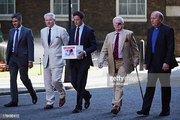 The greatgrandson of Winston Churchill Alexander Perkins arrives in Downing Street to deliver a petition on August 14 2013 in London England The...