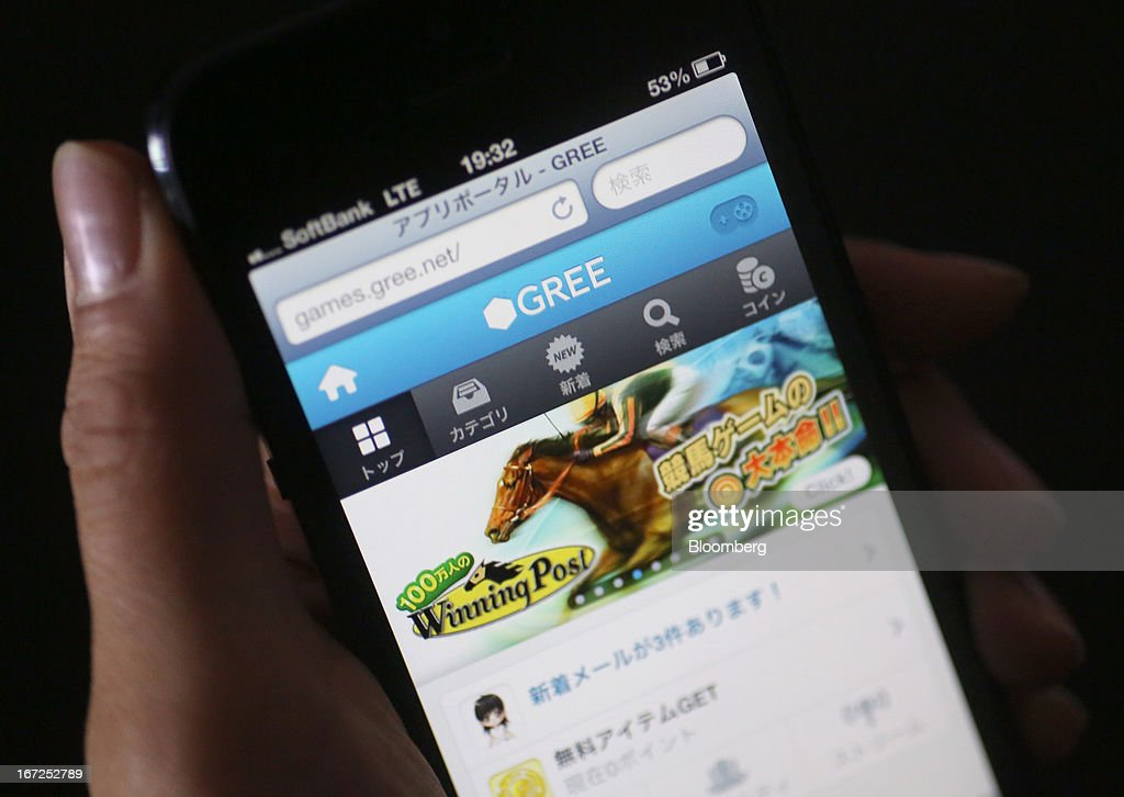 The Gree Inc. logo on the company's website is displayed on a smartphone in Tokyo, Japan, on Monday, April 22, 2013. Founded in 2004, Gree started as a social-networking service for mobile phones and began offering games through its networking platform three years later. Photographer: Yuriko Nakao/Bloomberg via Getty Images