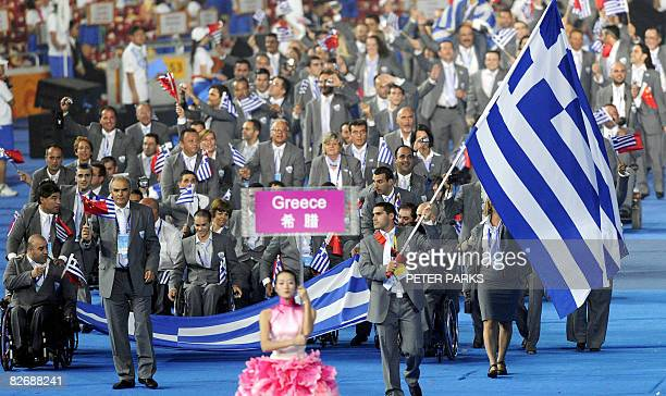 The Greece delegation parades during the 2008 Beijing Paralympic Games opening ceremony at the National Stadium better known as the Bird's Nest in...