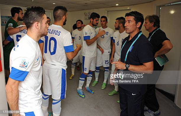 The Greece manager Kostas Tsanas talks to his players before the FIFA U20 World Cup Round of 16 match between Greece and Uzbekistan at Kamil Ocak...