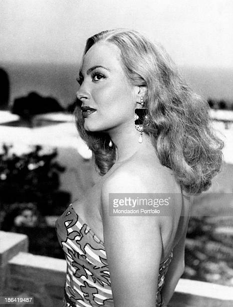 The Greek actress Yvonne Sanson naturalized Italian portrayed in profile on a terrace overlooking the sea she's playing the role of Australia a girl...
