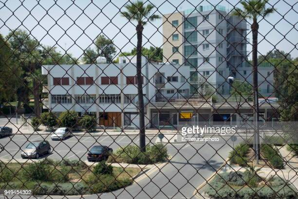 the greek cypriot side of nicosia seen behing fences. - emreturanphoto stock pictures, royalty-free photos & images
