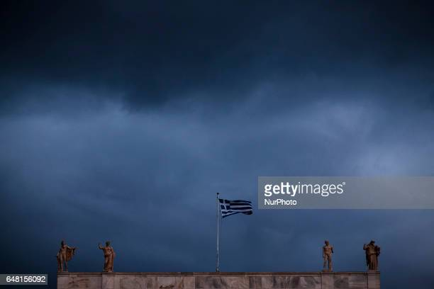 The Greek flag flutters on the Archeological Museum in Central Athens December 23 2016