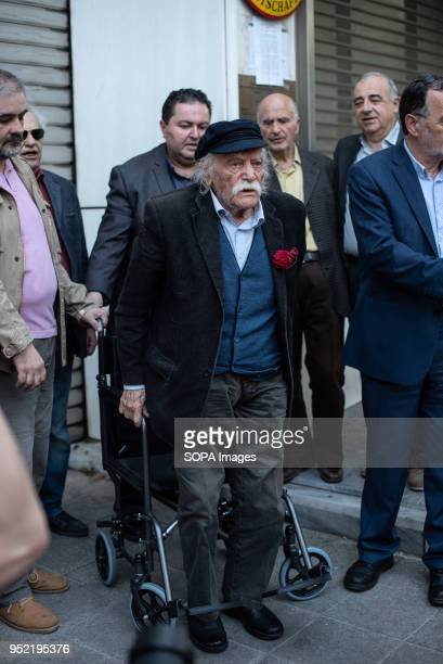 The Greek hero of National Resistance Manolis Glezos seen standing up from his wheelchair to sing the National anthem First gathering at the Unknown...