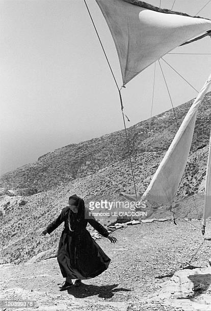 The Greek islands a vanishing world in Karpathos Greece in June 2000 Working windmill and miller Olympos village island of Karpathos